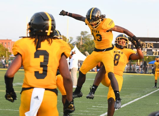 Detroit King's Rashawn Williams and Rishad Hence celebrate Williams' touchdown in the fourth quarter of the Crusaders' 47-7 win over Cass Tech on Friday.