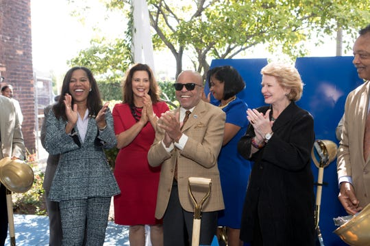 Elesha Bridgers, Gov. Gretchen Whitmer, Berry Gordy, Robin Terry, Sen. Debbie Stabenow and Rev. Jesse Jackson.