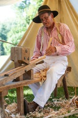 """""""I've been doing it for over 20 years now,"""" says Darrell Thurston of Pulaski, Ill., as he smooths wood for basket weaving at Kunstfest in New Harmony, Ind., Saturday afternoon, Sept. 21, 2019."""