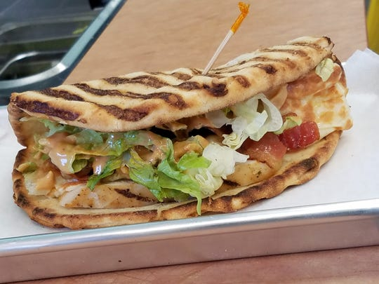 A chipotle chicken club flatbread sandwich from Tropical Smoothie Cafe.