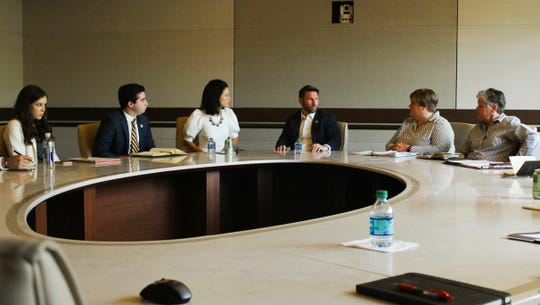 Rep. David Silvers (center) discussed his medical amnesty legislation with student leaders.