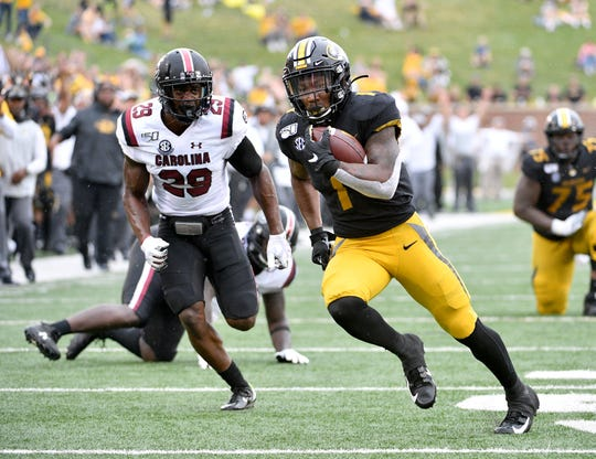 Missouri running back Tyler Badie (1) runs the ball against South Carolina defensive back J.T. Ibe (29) during the second half at Memorial Stadium/Faurot Field Saturday in Columbia, Mo. . Mandatory Credit: Denny Medley-USA TODAY Sports