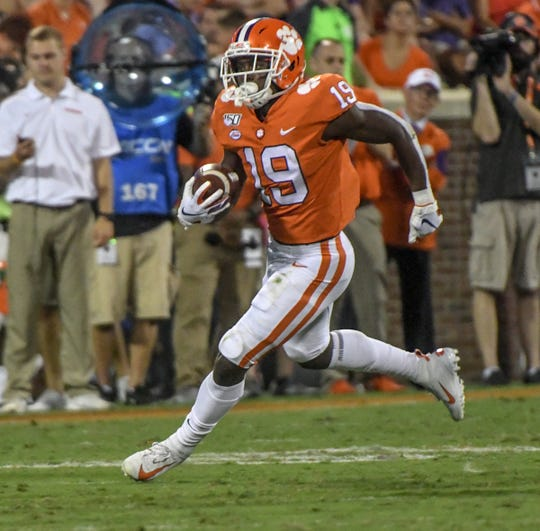 Clemson freshman running back Michel Dukes (19) runs against Charlotte during the third quarter at Memorial Stadium in Clemson, South Carolina Saturday, September 21, 2019.