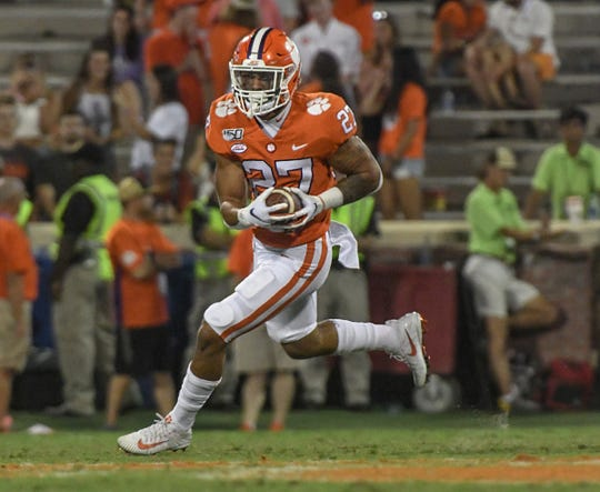 Clemson running back Chez Mellusi(27) runs for a gain against Charlotte during the third quarter at Memorial Stadium in Clemson, South Carolina Saturday, September 21, 2019.