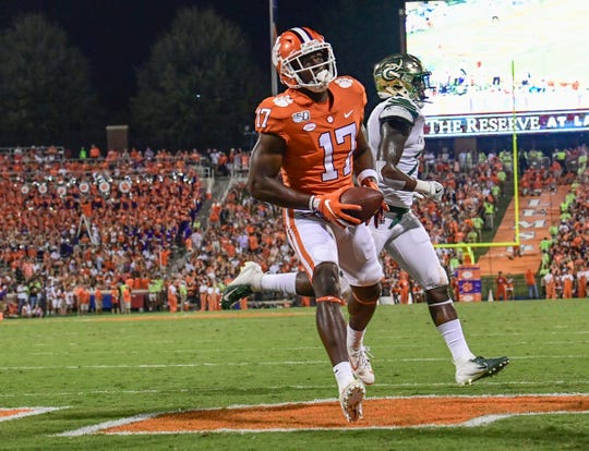 Clemson wide receiver Cornell Powell (17) scores against Charlotte during the first quarter at Memorial Stadium in Clemson, South Carolina Saturday, September 21, 2019.