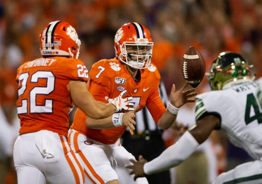 Clemson quarterback Chase Brice (7) passes the ball to Clemson wide receiver Will Swinney (22) during the game at Clemson's Memorial Stadium Saturday, Sept. 21, 2019.