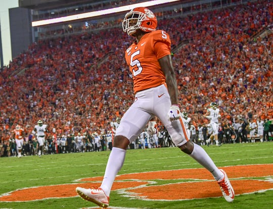 Clemson wide receiver Tee Higgins (5) celebrates scoring on a 58-yard touchdown play during the first quarter at Memorial Stadium in Clemson, South Carolina Saturday, September 21, 2019.