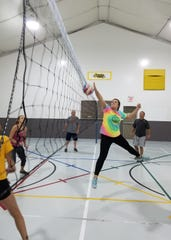 Sober Life participants enjoy camaraderie and fellowship with activities such as volleyball.
