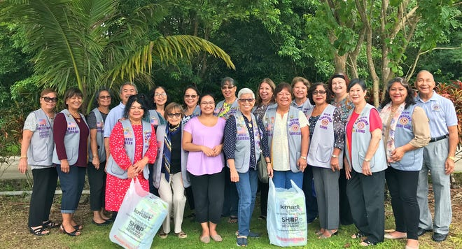 In keeping with its service project of caring for the sick and the elderly, Guam Sunshine Lions Club members visited Milagros Hart, 79, of Yigo, on Sept. 14, bringing supplies and cheer. Pictured in front from left: Lions Connie Rivera, Sid Weedin, Ashley Cepeda (granddaughter, who received supplies on behalf of Hart), Jovie Mejorada, Jojo Pillsbury, Mary Castro, Marietta Camacho, and Lorraine Rivera. Back row from left: Lions Jill Pangelinan, Mary Taitano, Dot Leon Guerrero, Johnny Villagomez, Linda Villagomez, Marie Salas, Annie Artero, Clarice Quichocho, Sita Crisostomo, Doris Cruz, and Pete Babauta.