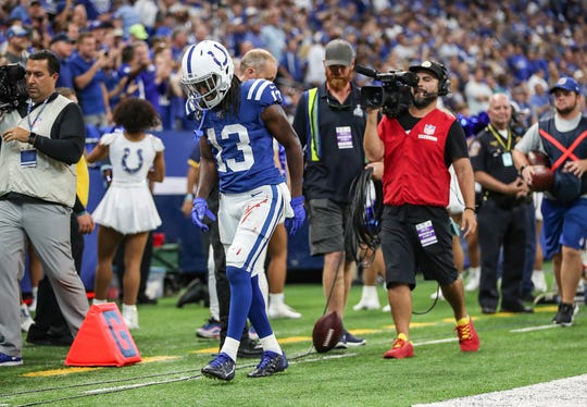 Indianapolis Colts wide receiver T.Y. Hilton (13) leaves the field injured after a touchdown at the end of the first half of their game at Lucas Oil Stadium in Indianapolis, Sunday, Sept. 22, 2019.