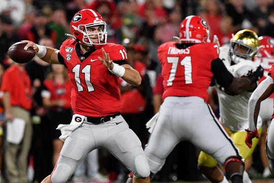 Georgia quarterback Jake Fromm (11) works in the pocket against Notre Dame during the first half of an NCAA college football game, Saturday, Sept. 21, 2019, in Athens, Ga. (AP Photo/Mike Stewart)