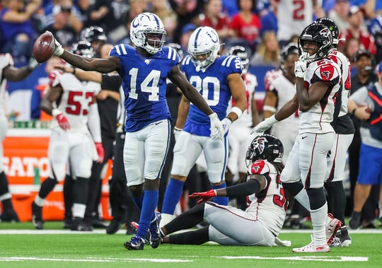 Indianapolis Colts wide receiver Zach Pascal (14) celebrates an offensive play in the fourth quarter of their game at Lucas Oil Stadium in Indianapolis, Sunday, Sept. 22, 2019.