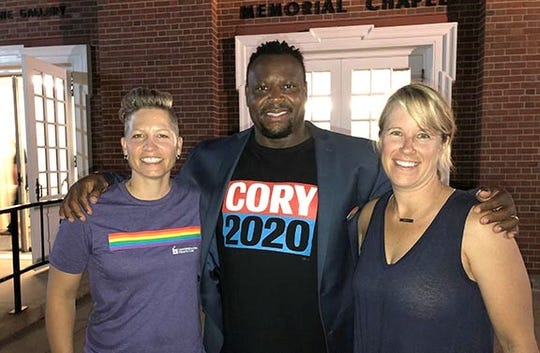 Attendees at Friday's LGBTQ forum included Dr. Katie Imborek of the University of Iowa's LGBTQ clinic and her wife Paula, and Iowa City City Council Member Bruce Teague.