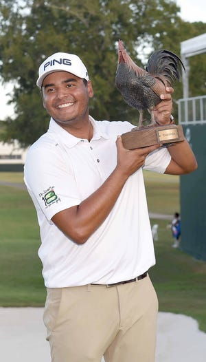 Sebastian Munoz poses with Reveille the Rooster, the Sanderson Farms Championship trophy, after winning the tournament paring the one-hole playoff with Sungjae Im and finishing at -18 on Sunday, September 22, 2019, at the Country Club of Jackson in Jackson, Miss.
