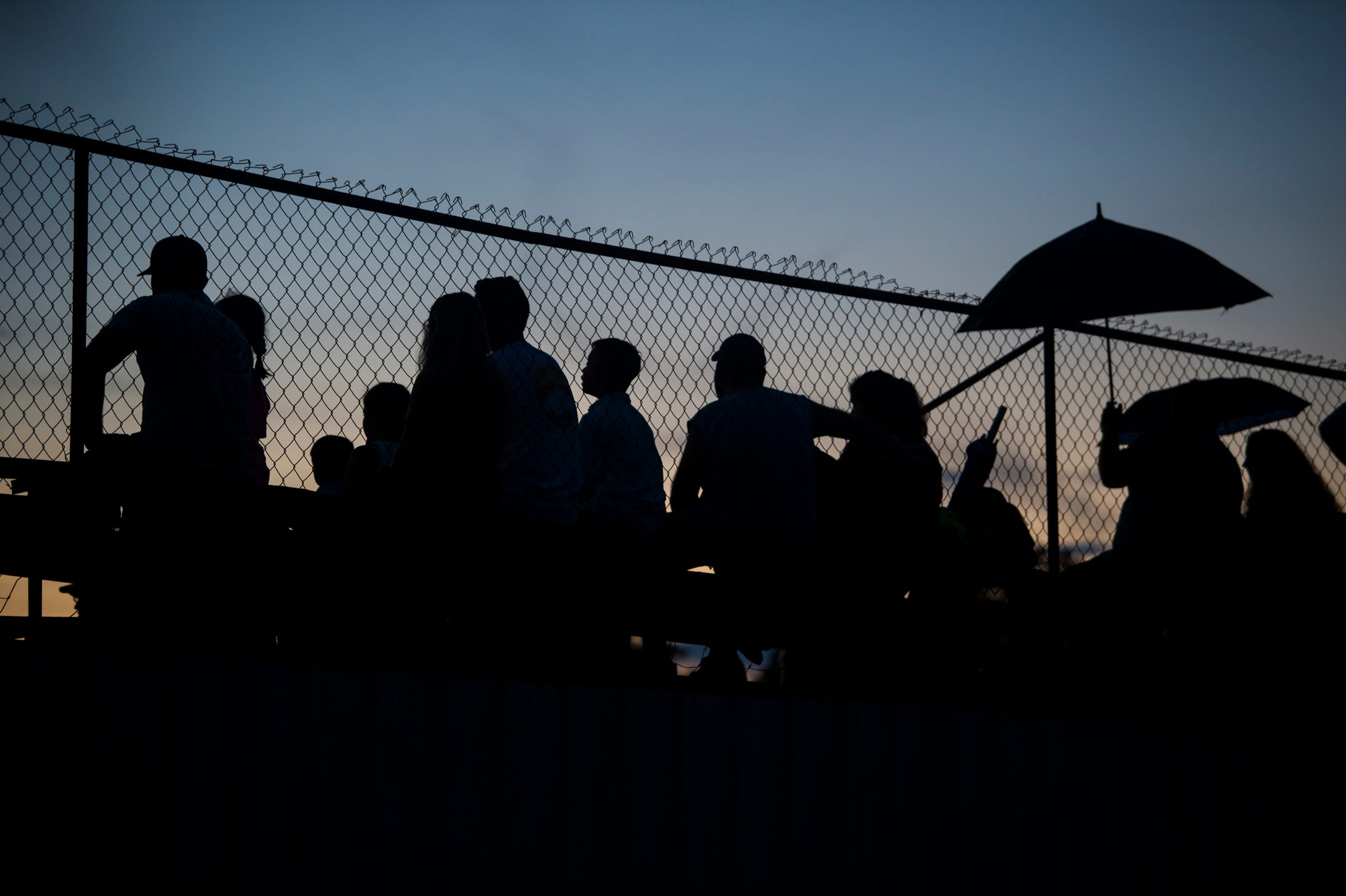 Race fans watch from the bleachers at Flomaton Speedway in Flomaton, Ala., on Saturday, Aug. 24, 2019.