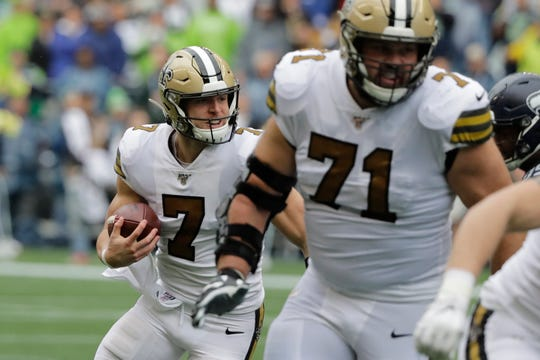 New Orleans Saints' Taysom Hill (7) runs with the ball against the Seattle Seahawks during the second half of an NFL football game, Sunday, Sept. 22, 2019, in Seattle. (AP Photo/Ted S. Warren)