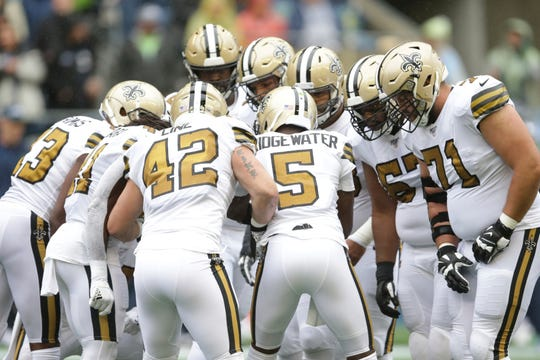 New Orleans Saints quarterback Teddy Bridgewater (5) leads a huddle against the Seattle Seahawks during the first half of an NFL football game, Sunday, Sept. 22, 2019, in Seattle. (AP Photo/Scott Eklund)