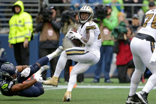 New Orleans Saints' Alvin Kamara, center, spins around as Seattle Seahawks' Mychal Kendricks (56) misses the tackle during the second half of an NFL football game Sunday, Sept. 22, 2019, in Seattle. (AP Photo/Scott Eklund)