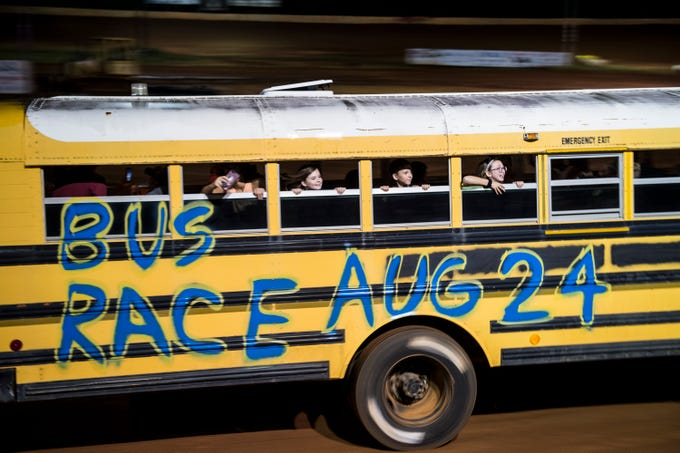 Kids get to ride around the track in buses before the races start at Flomaton Speedway in Flomaton, Ala., on Saturday, Aug. 24, 2019.