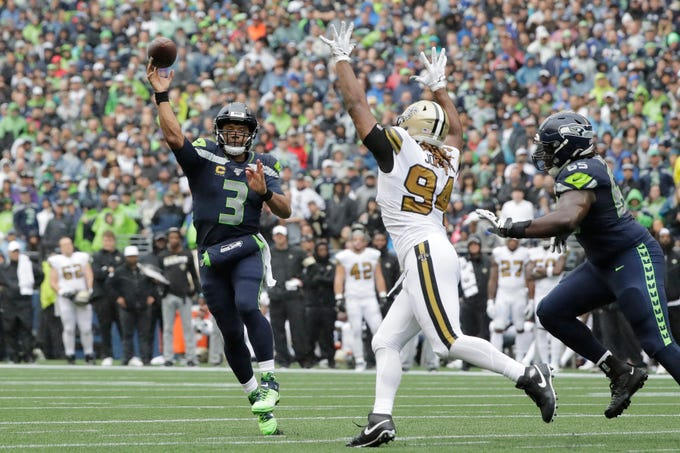 Seattle Seahawks quarterback Russell Wilson (3) throws a touchdown pass as New Orleans Saints' Cameron Jordan defends during the first half of an NFL football game Sunday, Sept. 22, 2019, in Seattle. (AP Photo/Ted S. Warren)
