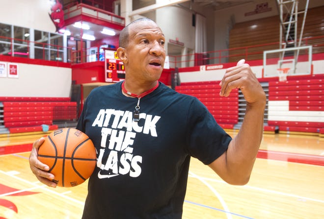 Jeffersonville's new varsity head basketball coach Chris Moore runs his team through drills during a practice on Sept. 18, 2019.