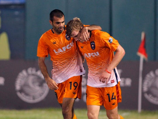 Lansing Ignite's Pato Botello-Faz, left, congratulates Nick Moon on his goal against South Georgia Tormenta, Saturday, Sept. 21, 2019, at Cooley Law School Stadium in Lansing, Mich.