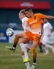 Lansing Ignite's Xavier Gomez, right, and South Georgia Tormenta's Charlie Dennis battle, Saturday, Sept. 21, 2019, at Cooley Law School Stadium in Lansing, Mich.