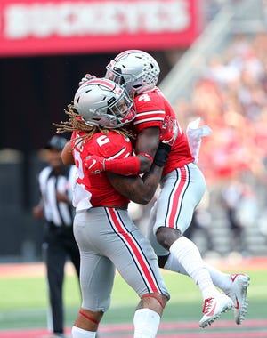 Ohio State safety Jordan Fuller (4) congratulates end Chase Young after one of his two strip-sacks in the second quarter of Saturday's 76-5 romp past Miami of Ohio.