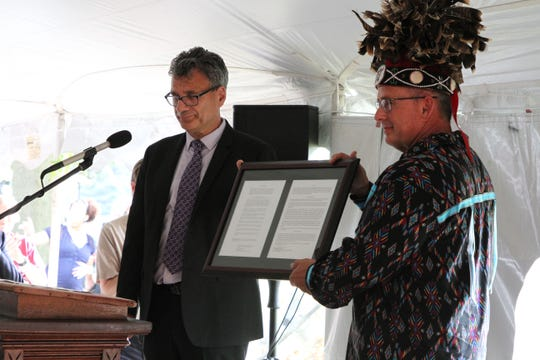 Thomas Kemper, General Secretary, Global Ministries for the United Methodist Church, presented a certificate to Chief Billy Friend, deeding back land in Upper Sandusky to the Wyandotte Nation.