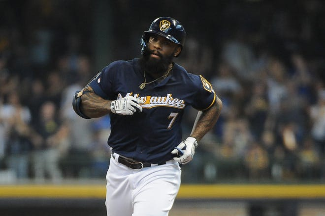Brewers first baseman Eric Thames rounds the bases after hitting his second home run Sunday against the Pirates.
