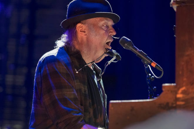 Neil Young performs at Farm Aid Saturday, Sept. 21, 2019, at Alpine Valley  Music Theatre in East Troy, Wis. Young co-founded Farm Aid 34 years ago with Willie Nelson and John Mellencamp.
