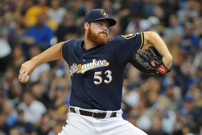 Sep 22, 2019; Milwaukee, WI, USA;  Milwaukee Brewers starting pitcher Brandon Woodruff (53) delivers a pitch against the Pittsburgh Pirates in the first inning at Miller Park. Mandatory Credit: Michael McLoone-USA TODAY Sports