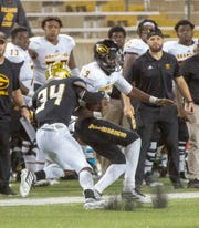 Grambling's Geremy Hickbottom is brought down near the sideline by ASU defensive back Devon Booker (34).