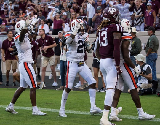 Auburn defensive backs Christian Tutt (6), Jeremiah Dinson (20) and Javaris Davis (13) celebrate after knocking down a pass intended for Texas A&M wide receiver Kendrick Rogers (13) at Kyle Field in College Station, Texas, on Saturday, Sept. 21, 2019. Auburn defeated Texas A&M 28-20.