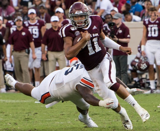 Texas A&M quarterback Kellen Mond (11) avoids Auburn defensive lineman Derrick Brown (5) at Kyle Field in College Station, Texas, on Saturday, Sept. 21, 2019. Auburn defeated Texas A&M 28-20.