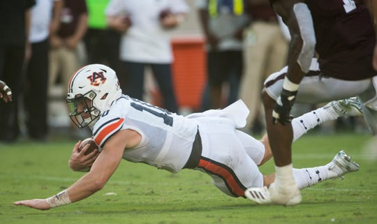 Auburn quarterback Bo Nix (10) dives forward for a few extra yards at Kyle Field in College Station, Texas, on Saturday, Sept. 21, 2019. Auburn defeated Texas A&M 28-20.