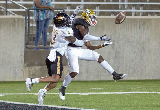 ASU wide receiver Jeremiah Hixon (1) extends his hands for a pass to the end zone as Grambling's Kevin Dominique tries to block it.