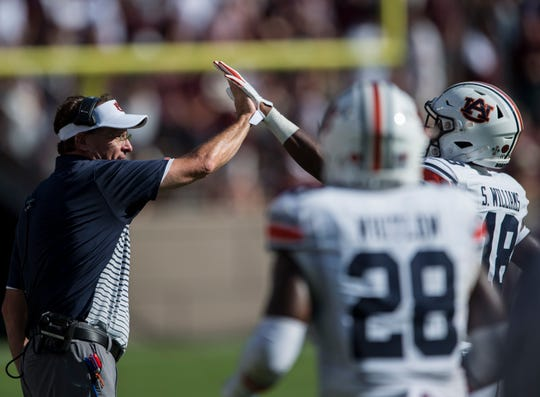 Auburn head coach Gus Malzahn high fives Auburn wide receiver Seth Williams (18) at Kyle Field in College Station, Texas, on Saturday, Sept. 21, 2019. Auburn defeated Texas A&M 28-20.