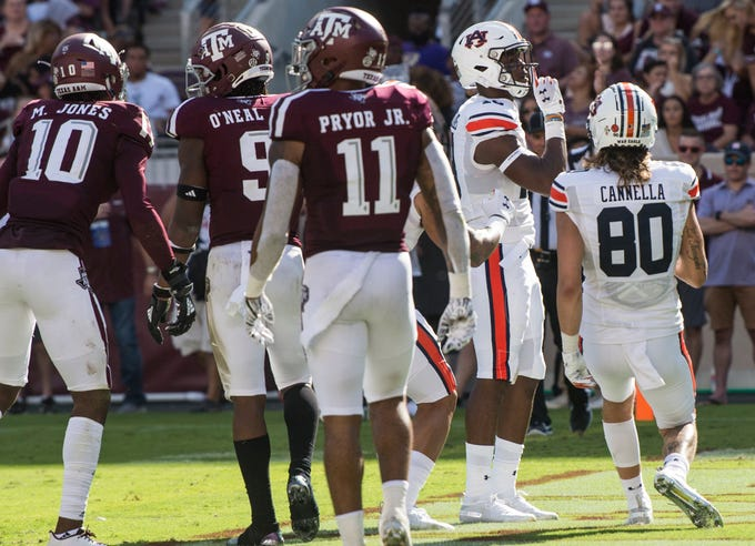 Auburn wide receiver Seth Williams (18) silences the crowd after scoring a touchdown at Kyle Field in College Station, Texas, on Saturday, Sept. 21, 2019. Auburn defeated Texas A&M 28-20.