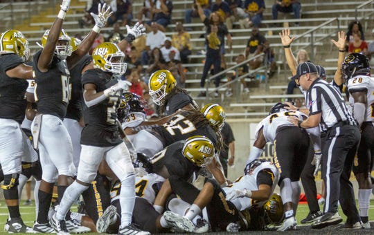 The Hornets celebrate a successful push to the end zone during the second half against Grambling.
