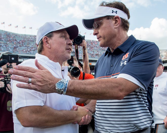 Texas A&M head coach Jimbo Fisher and Auburn head coach Gus Malzahn shake hands after the game at Kyle Field in College Station, Texas, on Saturday, Sept. 21, 2019. Auburn defeated Texas A&M 28-20.