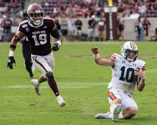 Auburn quarterback Bo Nix (10) slides after securing the game winning first down at Kyle Field in College Station, Texas, on Saturday, Sept. 21, 2019. Auburn defeated Texas A&M 28-20.