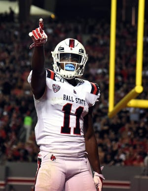 Sep 21, 2019; Raleigh, NC, USA; Ball State Cardinals wide receiver Justin Hall (11) points to the crowd after scoring a touchdown during the first half against the North Carolina State Wolfpack at Carter-Finley Stadium. Mandatory Credit: Rob Kinnan-USA TODAY Sports