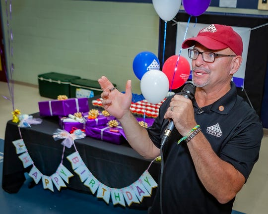 Daryl Mackin, executive director of A Soldier's Child, talks about the organization's mission during a surprise party for 10-year-old Jasmin Thompson at Providence Christian Academy on Sept. 14, 2019.