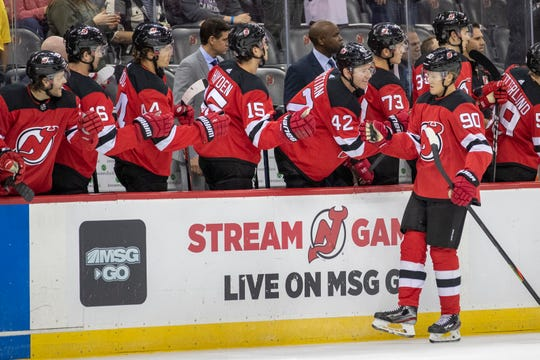 New Jersey Devils center Jesper Boqvist (90) celebrates with his teammates after scoring during the first period of a preseason NHL hockey game against the New York Islanders, Saturday, Sept. 21, 2019, in Newark, N.J.