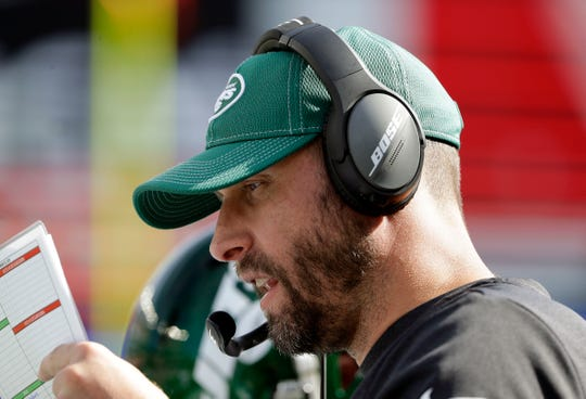 New York Jets head coach Adam Gase works along the sideline in the second half of an NFL football game against the New England Patriots, Sunday, Sept. 22, 2019, in Foxborough, Mass. (AP Photo/Steven Senne)