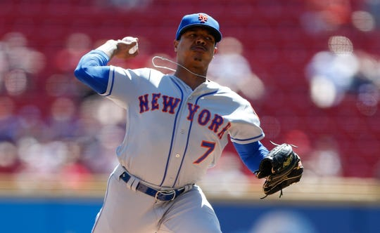 New York Mets starting pitcher Marcus Stroman (7) throws against the Cincinnati Reds during the first inning of a baseball game, Sunday, Sept. 22, 2019, in Cincinnati. (AP Photo/Gary Landers)