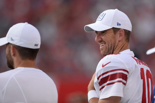 New York Giants quarterback Eli Manning (10) smiles on the bench against the Tampa Bay Buccaneers during the second half of an NFL football game Sunday, Sept. 22, 2019, in Tampa, Fla. (AP Photo/Jason Behnken)