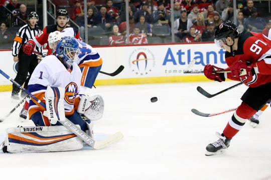 New Jersey Devils left wing Nikita Gusev (97) shoots to score past New York Islanders goaltender Thomas Greiss (1) during the second period of a preseason NHL hockey game, Saturday, Sept. 21, 2019, in Newark, N.J.