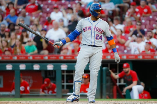 New York Mets' Robinson Cano reacts after striking out against Cincinnati Reds relief pitcher Raisel Iglesias in the ninth inning of a baseball game, Saturday, Sept. 21, 2019, in Cincinnati. (AP Photo/John Minchillo)